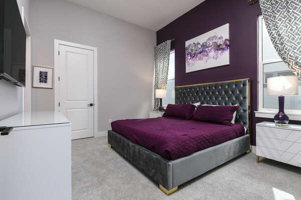 Get a good night's rest in this bedroom with a king-size bed