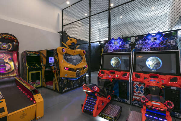 The games room is filled with different arcade games, fun for all ages!