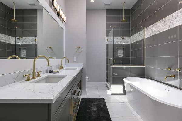 Ensuite bathroom with dual sink vanity, garden tub and walk-in shower