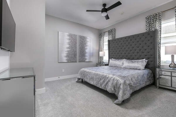 Sink into this king-size bed after running around Orlando