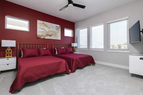 Sleep soundly in this bedroom with 2 full-size beds, plenty of natural lighting and a TV