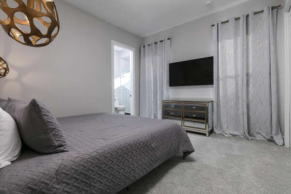 Lounge in this king-size bed and watch a movie