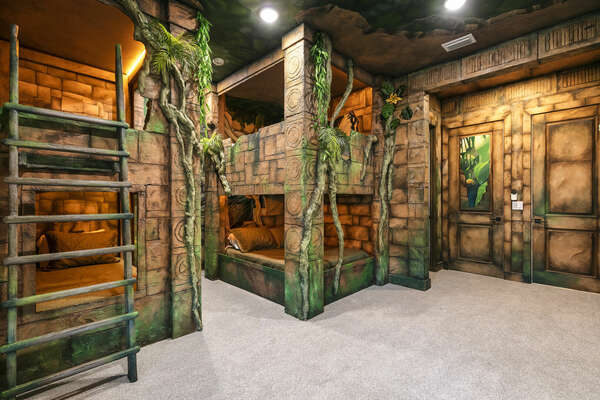Custom-built bunkbeds will make the kids feel like they're sleeping in the middle of a jungle