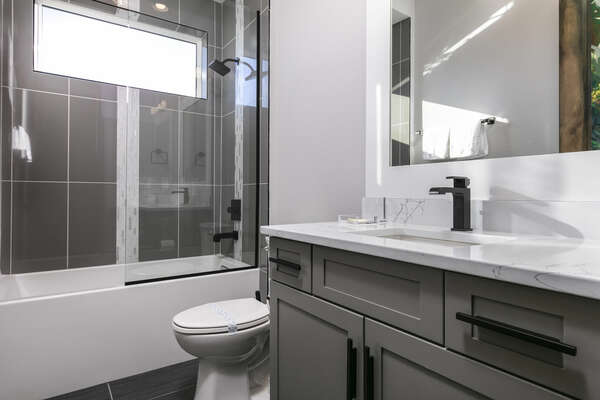Kids can get ready in this ensuite bathroom with a shower/tub combo