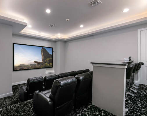 Grab some popcorn, sit back and enjoy a movie in the the home theater room