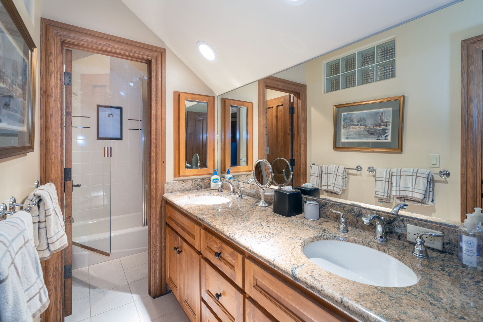 Double vanity sinks with separate shower room in this bathroom.