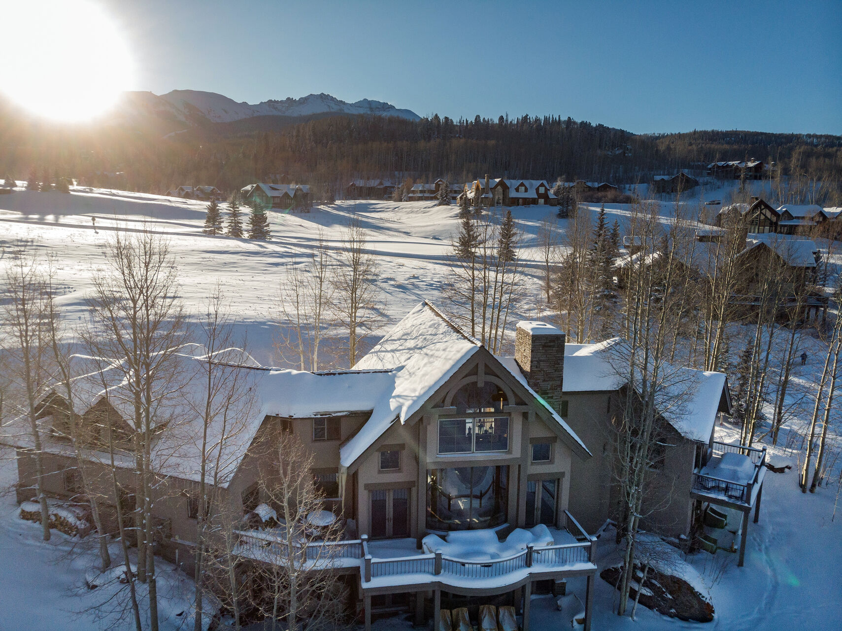 An external view of this Telluride golf rental, covered in snow.
