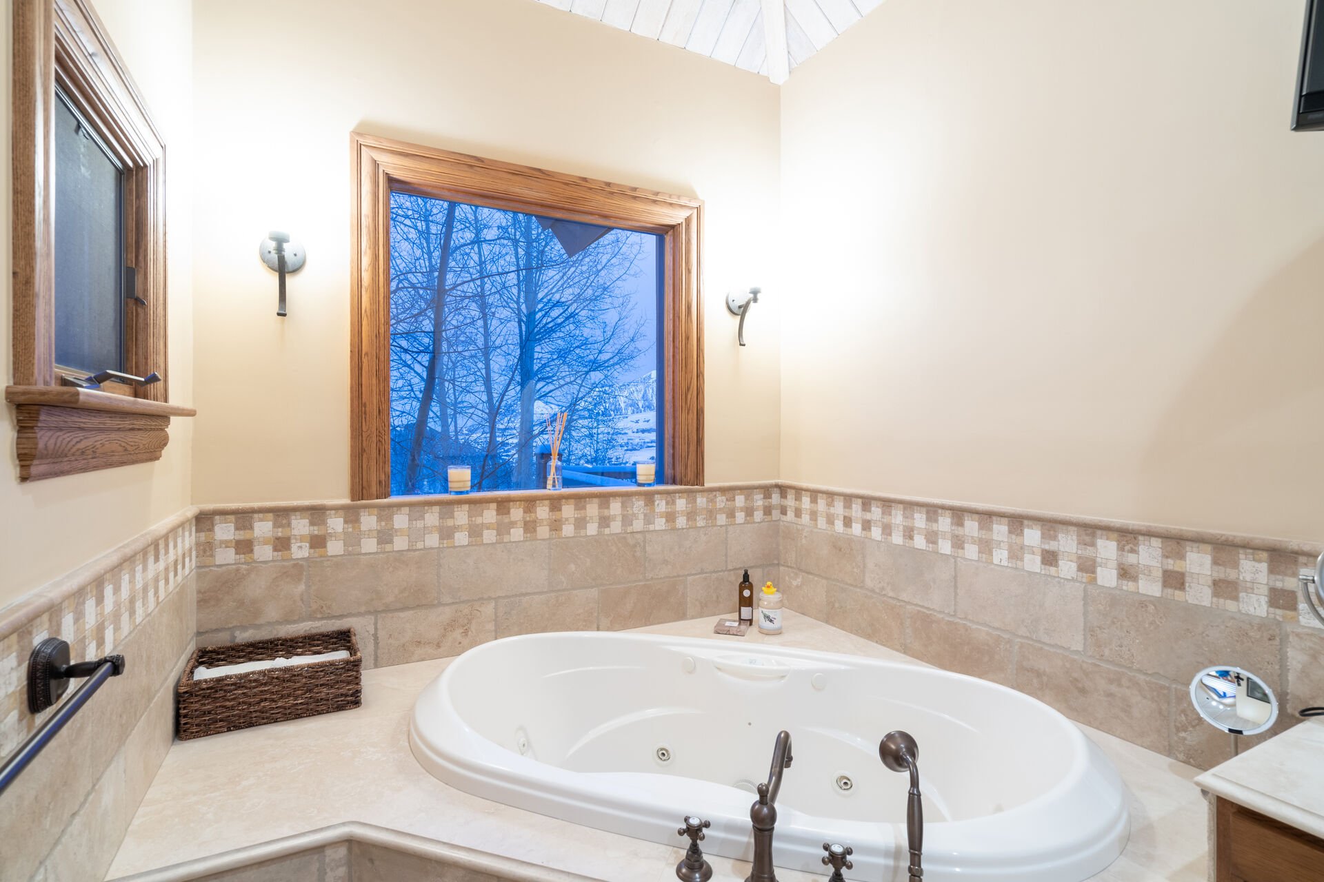 Spa tub with window above it.