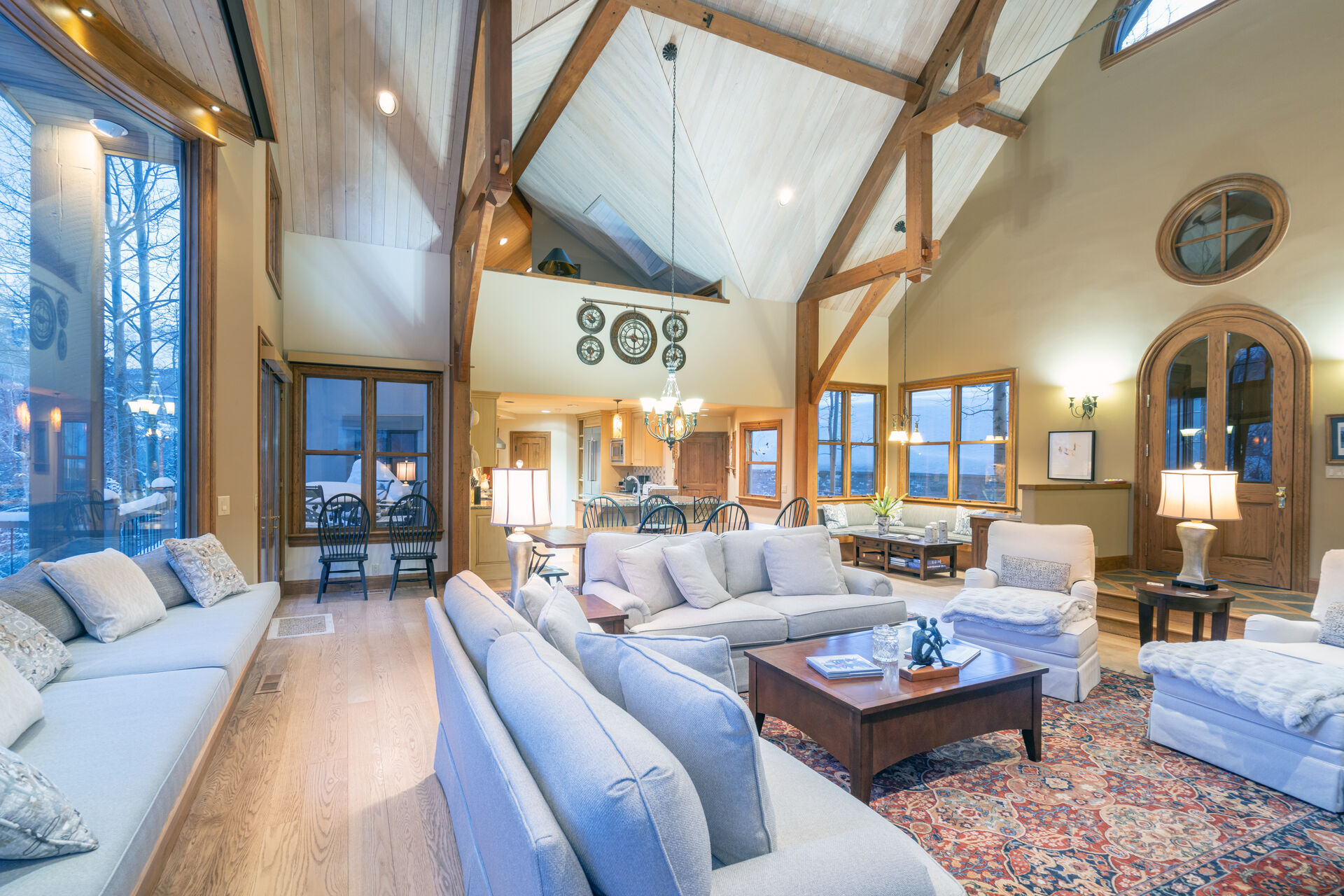 Multiple couches and armchairs in the living area of this Telluride golf rental, with a coffee table in the center.
