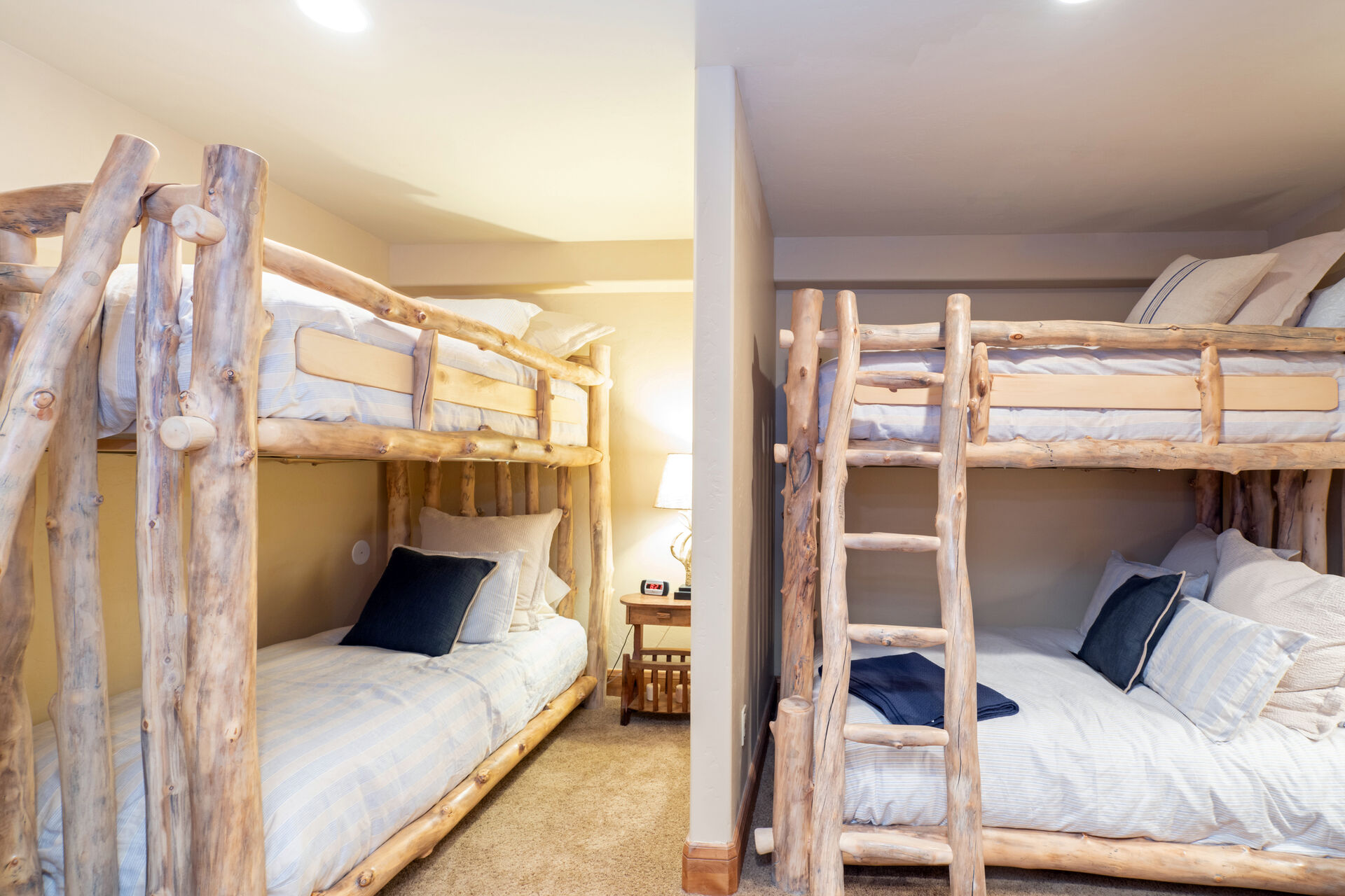 Two sets of bunk beds in a side bedroom.