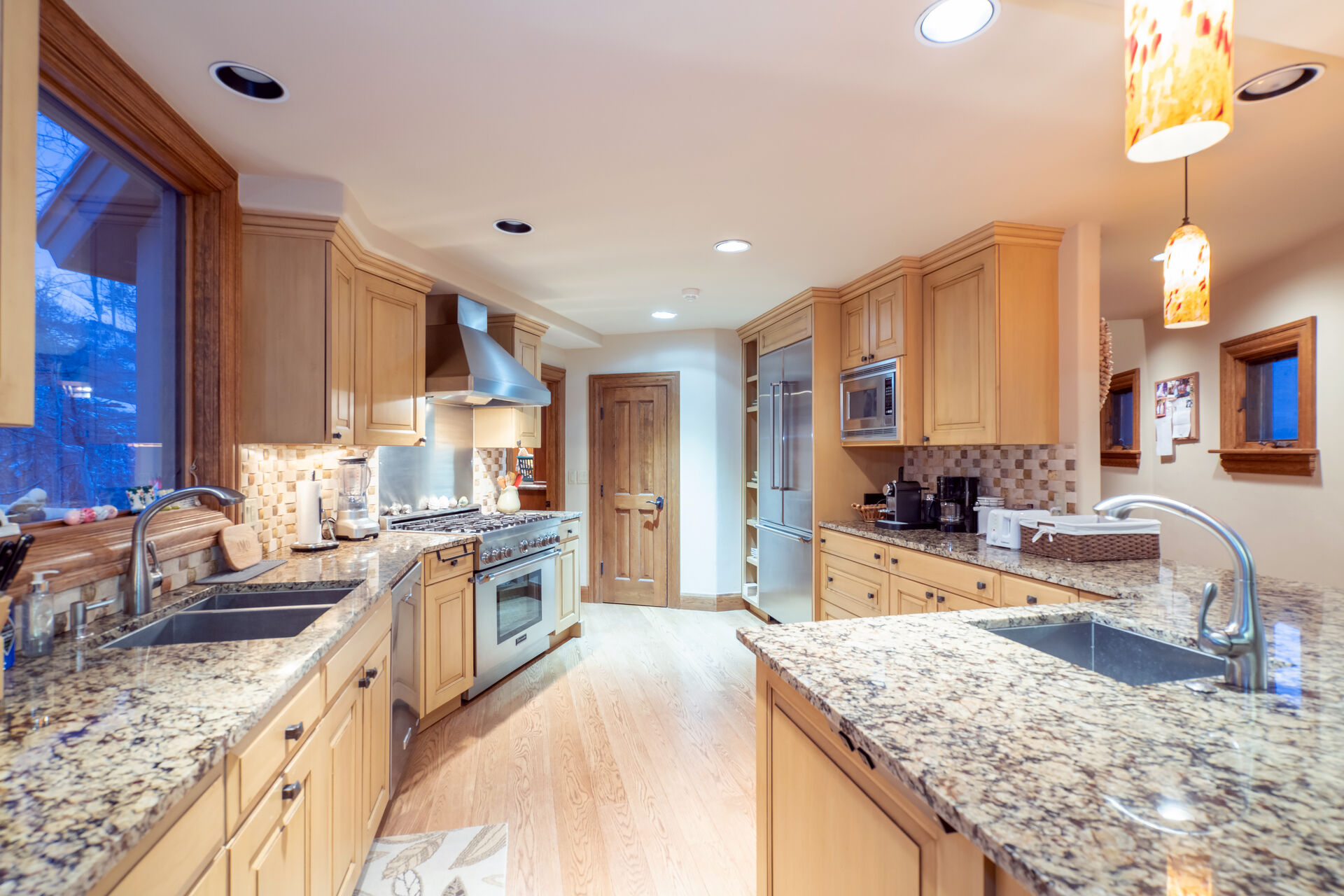 The kitchen of this Telluride golf rental, with two sinks and stainless steel appliances.