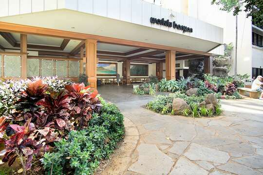 Beautiful, large lobby entry with a waterfall and kol fish  in its pond.  Spacious area for cars and tours  to load and unload with ease.