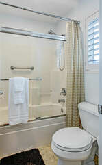 Second floor shared bathroom features a tub-shower combo.