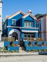 The Blue Jay home stands out in the downtown strip of Oceanside!