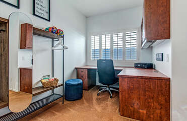 The bunk bed bedroom offers a large desk and small closet.