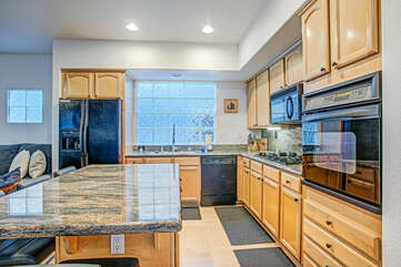 The large kitchen is equipped with everything you need to cook for the entire family.