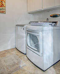 Laundry room with washer and dryer upstairs.