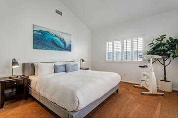 The master bedroom with a king bed and vaulted ceilings. There is also a spinner for those early workouts!
