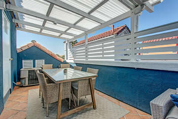 Rooftop deck dining for 8 people.