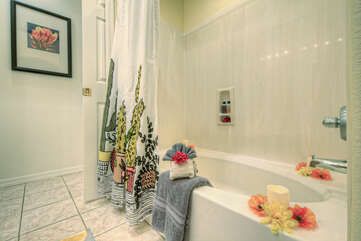 Primary bath includes a tub-shower combination for a refreshing rinse or soak after a day on the golf course
