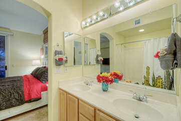 Primary bath has dual vanity sinks and wall length mirror