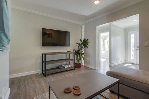 Modern TV Stand and Coffee Table in Living Area.