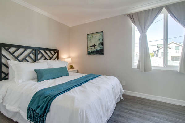 Second Floor Bedroom Features Queen Bed.