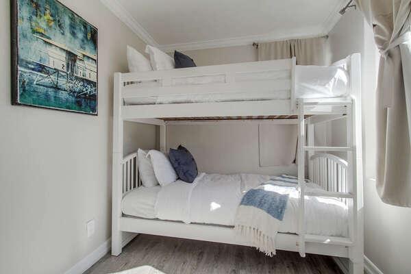 White Wooden Bunk Bed in Bedroom.