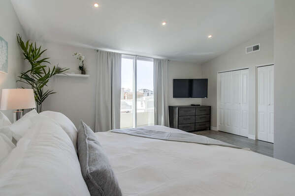 Master Bedroom Includes King Bed and Large TV.