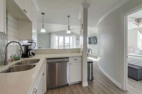 Kitchen Includes Beautiful White Counters.