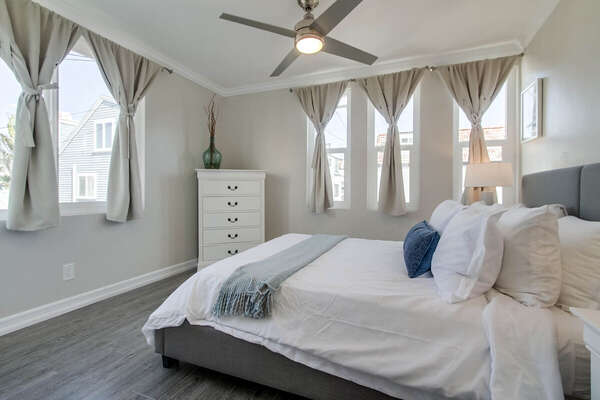 Guest Bedroom Features Many Large Windows.