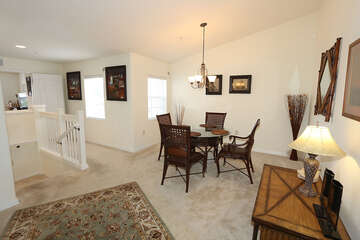 Dining area and stairs to garage adn front door