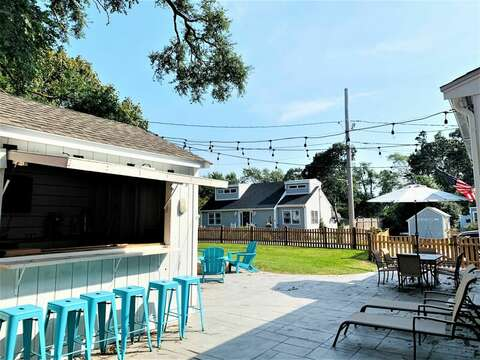 Out side entertainment area with Tiki bar, fire pit, patio furniture- 58 Depot St, Dennisport , New England Vacation Rentals