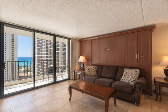 Wall to wall sliding glass doors, leads out to the private lanai, with an amazing ocean view.