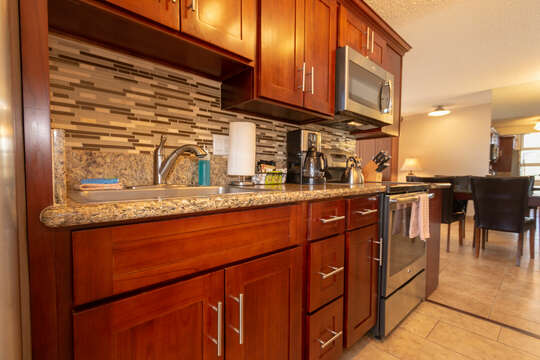 Kitchen has all stainless steel appliances and fully stocked kitchen wares.