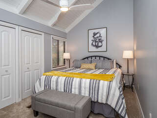 Vaulted ceiling and ceiling fan in guest bedroom