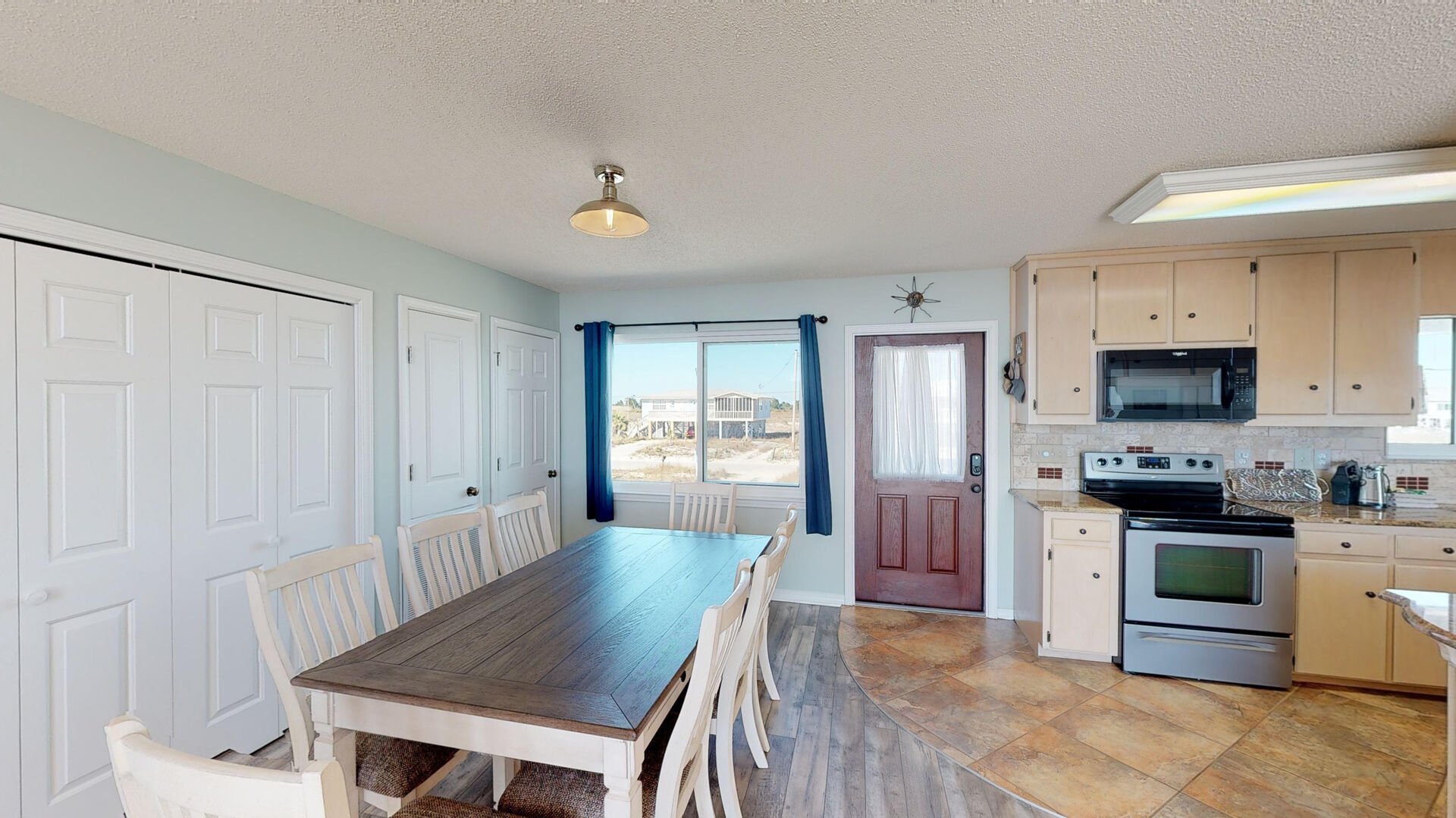 Open Dining and Kitchen Area in Ft Morgan Al Vacation Rental.