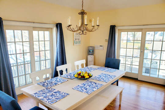 Dining  with sliders to deck-306 Millway Barnstable Cape Cod New England Vacation Rentals