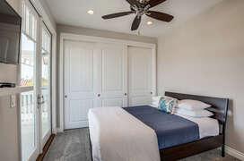 2nd guest bedroom with  queen bed
