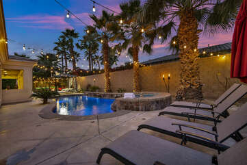 The resort style backyard highlights a large pool, spa, lounge chairs, two fire pits and much more!