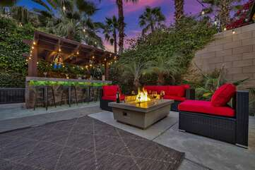 The lounge area is conveniently located next to the covered barbecue and bar area, which features 4 bar stools.