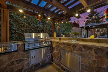 The covered outdoor kitchen with a built in barbecue is the best place to entertain.