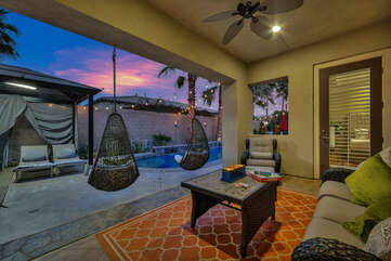 Located next to the patio dinner table is the second lounge area.