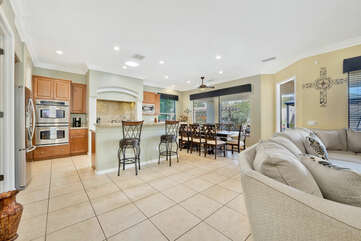 The open floor plan allows for an easy flow between the living area, kitchen and formal dinning.