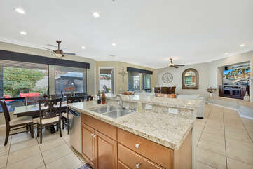 The open & spacious gourmet kitchen is fully stocked!