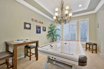 Move over to the game room, located near the kitchen. This fun room features a brand new Air Hockey table, and a bar-high game table, perfect for Dominoes or Chess.