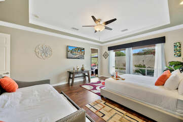 A Master Suite built for a king, with access to the backyard. This room features a King-sized bed, Twin-sized Daybed with Twin-Sized trundle and a full size private, en suite bathroom