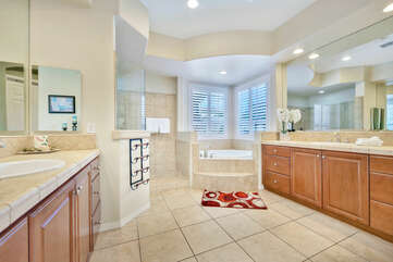 Master Suite Bathroom includes a soaking tub, tile shower and two vanity sinks.