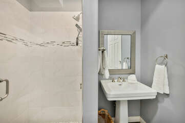 Suite 2 Bathroom features a tile shower and pedestal sink. We provide a starter set of L'Occitane soaps in each bathroom for your convenience.