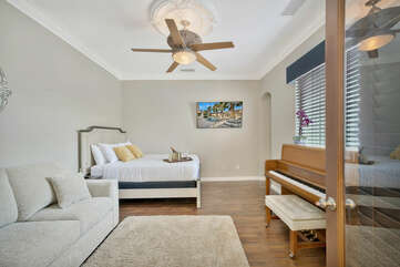 Show off you musical talent on the beautiful piano! Bedroom 4 also showcases a 55-inch TCL Smart Television.